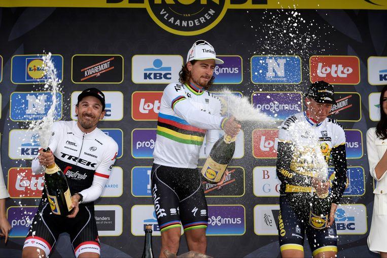 Dollen op het podium met Cancellara, Sagan en Vanmarcke
