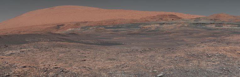 In de verlaten landschappen van Mars herken je ook een beetje de aarde. De rode planeet was ooit net zo blauw als onze thuis. Mogelijk was er zelfs ooit leven. Beeld NASA