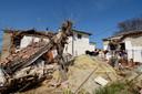 Vernielde huizen in de buurt van de Griekse stad Larissa.