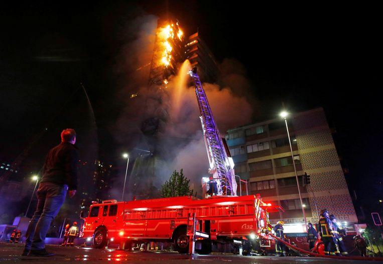 In het hoofdkantoor van energiebedrijf Enel woedde brand. Beeld REUTERS