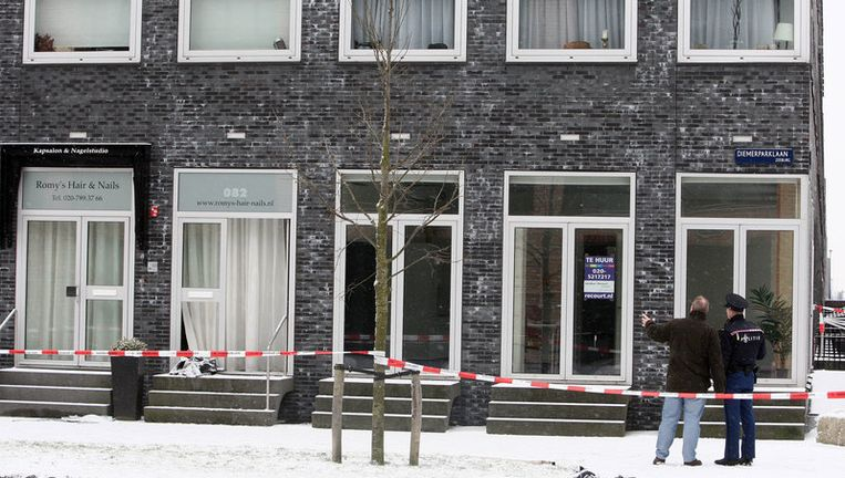 Politie zet de woning aan de Diemerparklaan af. Foto ANP Beeld