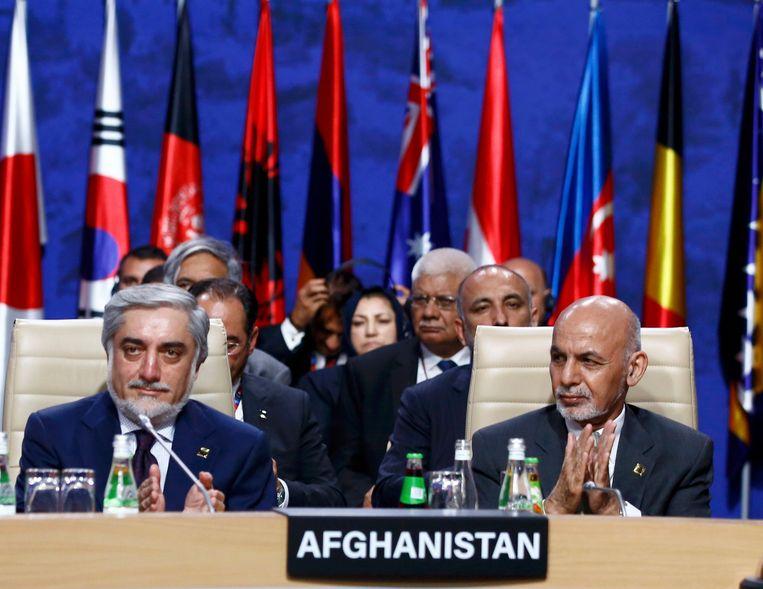 De Afghaanse president Ashraf Ghani en de Afghaanse executieve Abdullah Abdullah. Beeld REUTERS