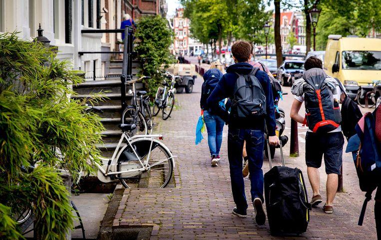 Airbnb-gasten in Amsterdam. Beeld anp