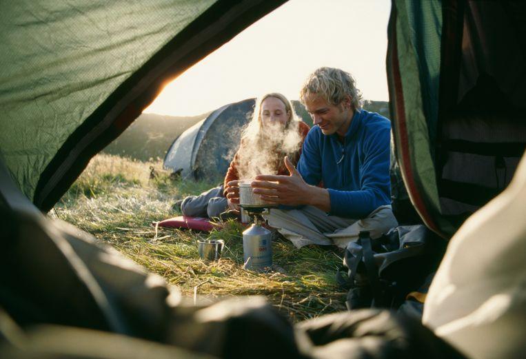 Koken op de camping Beeld Getty Images