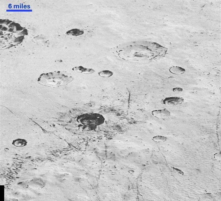 Gedetailleerde foto's van Pluto. Beeld REUTERS