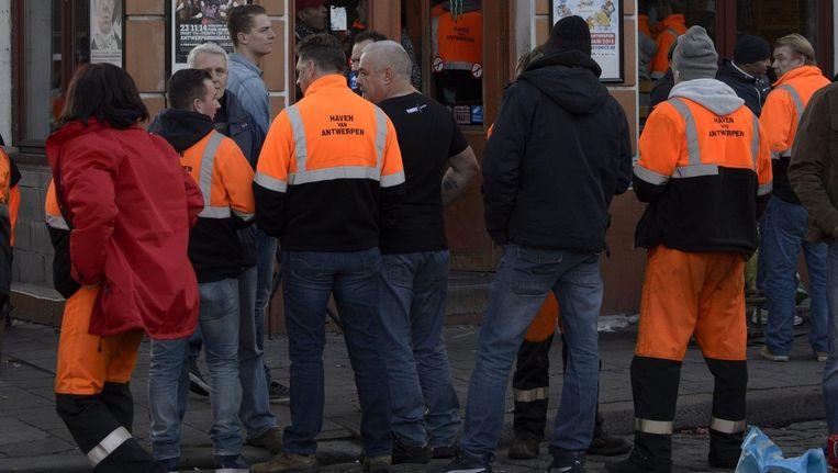 Antwerpse havenarbeiders. Beeld PHOTO_NEWS