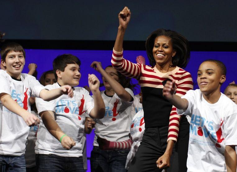 Michelle Obama volop in beweging voor haar 'Let's Move' campagne voor de Amerikaanse jeugd. Beeld reuters