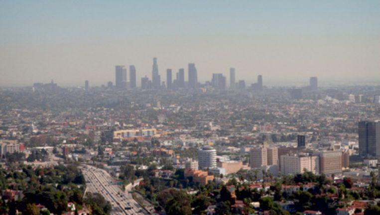 De skyline van Los Angeles gehuld in smog. Beeld UNKNOWN