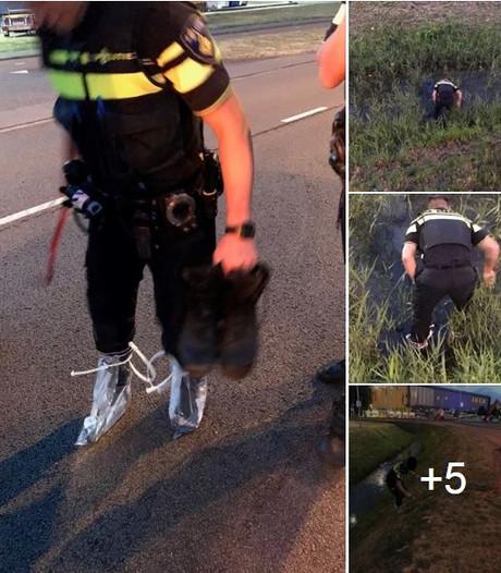 Politieman probeert vergeefs sokken en schoenen droog te houden