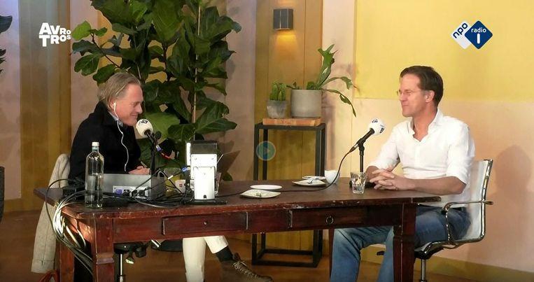 Jort Kelder en Mark Rutte tijdens de opname van het interview voor het programma Dr. Kelder & Co op Radio 1. Beeld NPO Radio 1
