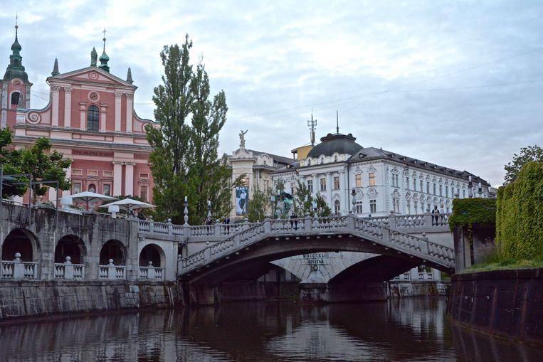 Tromostovje, ofwel de drie bruggen van architect Jože Plečnik, is een van de absolute hoogtepunten.  Beeld Myriam Thys