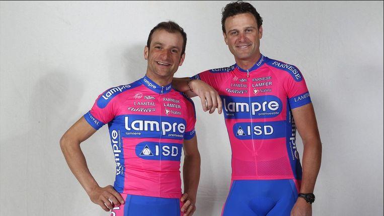 Michele Scarponi (links) en Alessandro Petacchi. Beeld PHOTO_NEWS