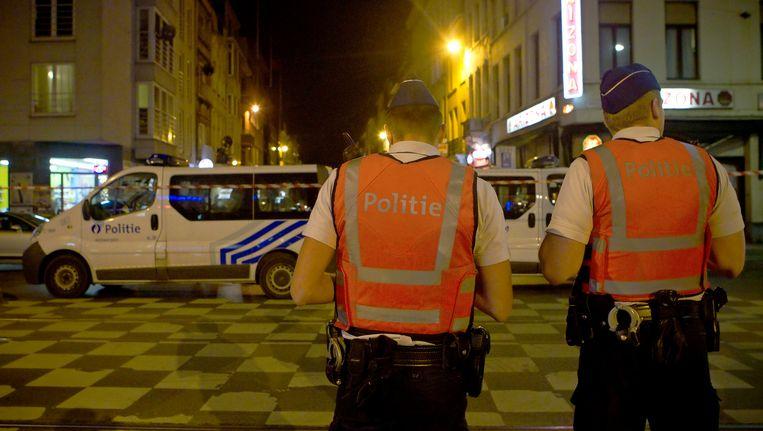 Politieagenten in de straten van Antwerpen. Beeld BELGA