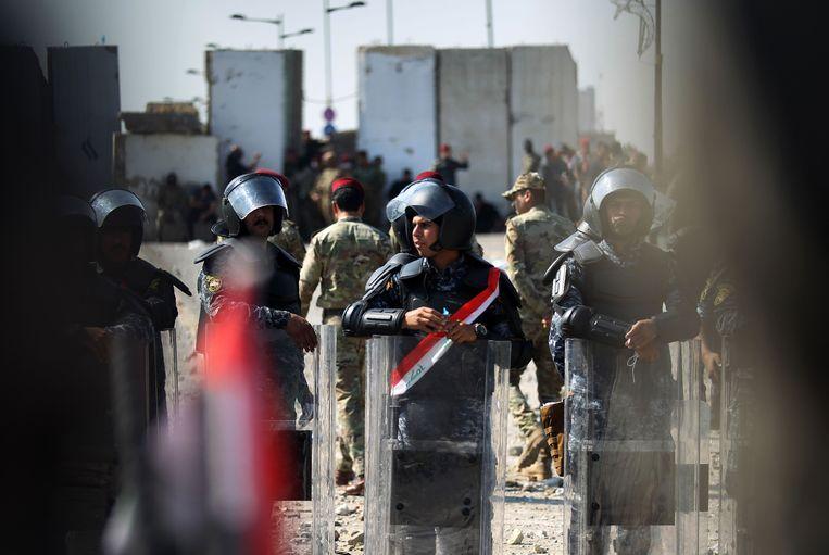 Iraakse veiligheidstroepen tijdens een antiregeringsprotest nabij hoofdstad Bagdad.