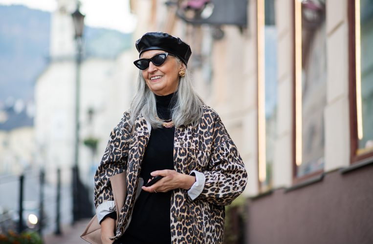 Old woman wearing fashionable clothes. Beeld Getty Images