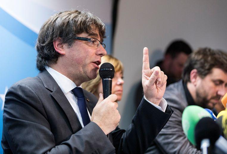 Carles Puigdemont, dinsdag tijdens een persconferentie in Brussel. Beeld Photo News