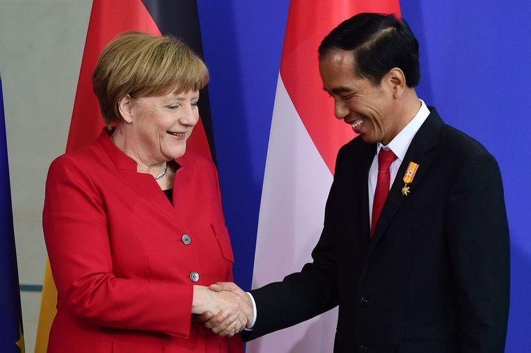 De Duitse bondskanselier Merkel met Widodo. Beeld Afp