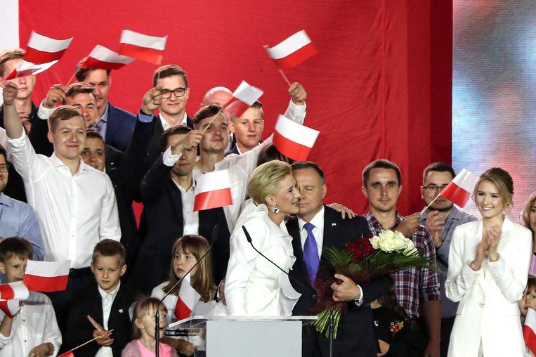 President Andrzej Duda en zijn vrouw Agata Kornhauser-Duda. Duda is opnieuw tot president van Polen verkozen. Beeld AP