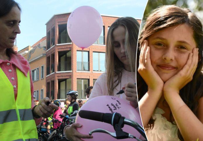 Wendy Demeestere en dochter Yana schrijven een boodschap voor Kato op een roze ballon.