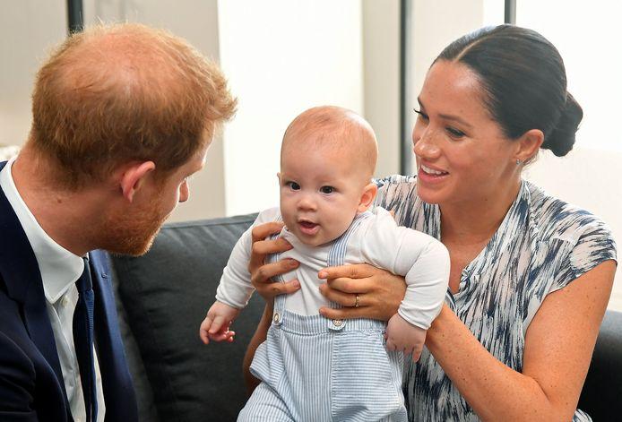 Le Prince William, Archie et Meghan Markle.