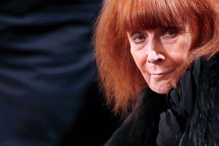 Sonia Rykiel in 2013. Zoals altijd gehuld in stijlvol zwart, met wit gepoederd gezicht en vuurrode haren. Beeld AFP