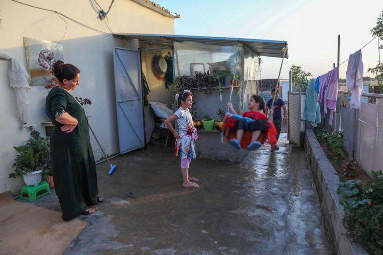 Iraanse Koerden in een vluchtelingenkamp in het Koerdische deel van Irak.  Beeld AFP