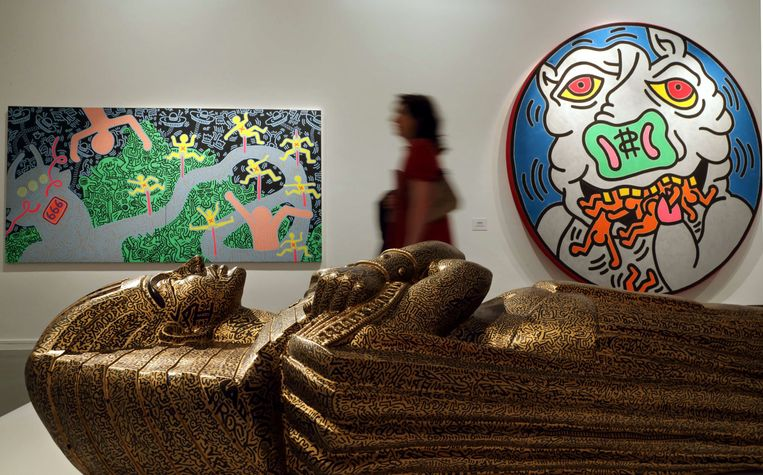 A visitor walks past 'Sarcophagus' (in collaboration with LAII), 1983, an art creation by the late American artist Keith Haring (1958-1990) during his retrospective exhibition at the Musee d'Art Moderne (Modern Art Museum) in Paris April 18, 2013. The exhibition