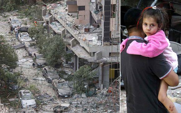 Een vader loopt met zijn dochter door de totaal verwoeste stad.
