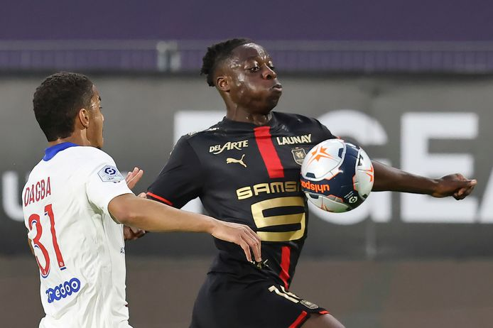 PSG's Colin Dagba, left, and Rennes' Jeremy Doku fight for the ball during a French League One Soccer match between Rennes and PSG at the Roazhon Park stadium in Rennes, France, Sunday, May 9, 2021. (AP Photo/David Vincent)