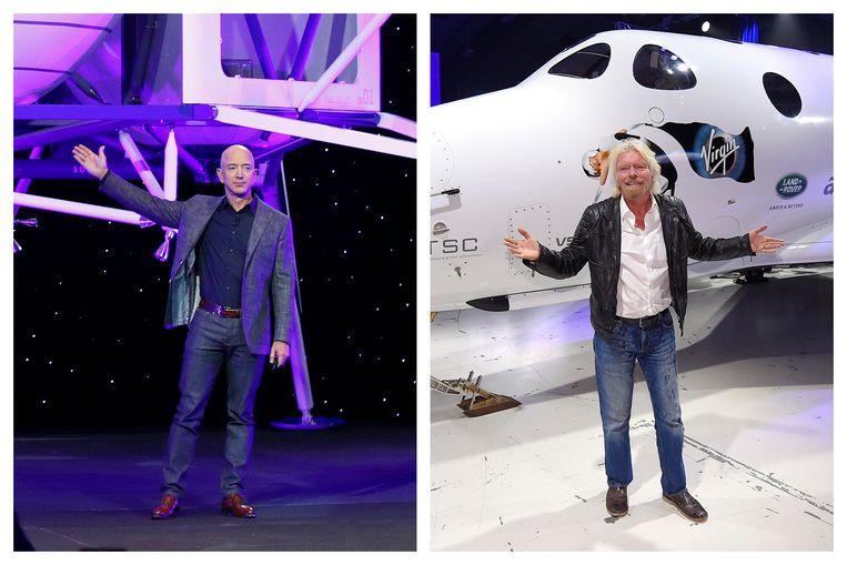 Jeff Bezos (links) met een model van Blue Origin's Blue Moon maanlander en Richard Branson met de toeristenraket SpaceShipTwo van Virgin Galactic. Beeld AP