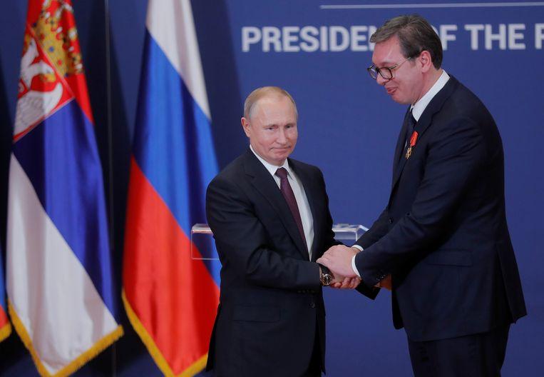 Poetin en de Servische president Alexandar Vucic in januari.  Beeld REUTERS