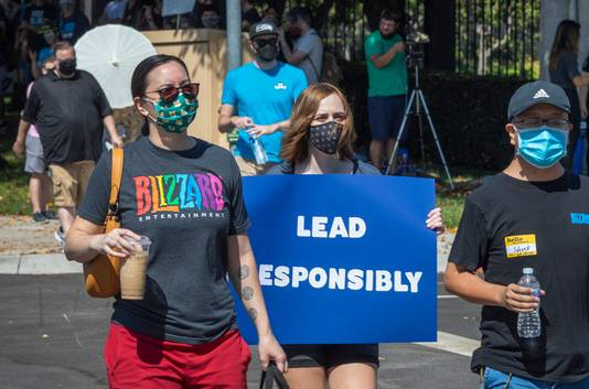 Employees of the video game company, Activision Blizzard, hold a walkout and protest rally to denounce the company's response to a California Department of Fair Employment and Housing lawsuit and to call for changes in conditions for women and other marginalized groups, in Los Angeles on July 28, 2021. (Photo by DAVID MCNEW / AFP)