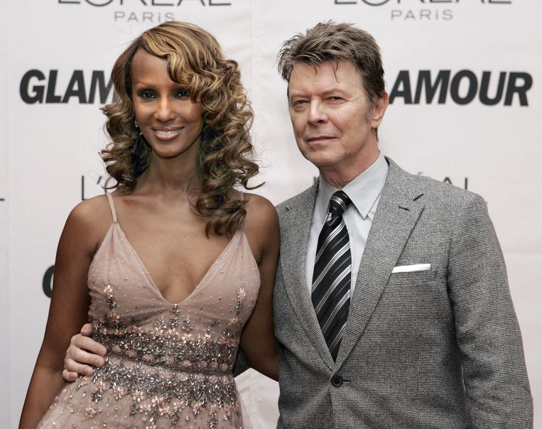 Iman (L) met haar overleden echtgenoot David Bowie (R)