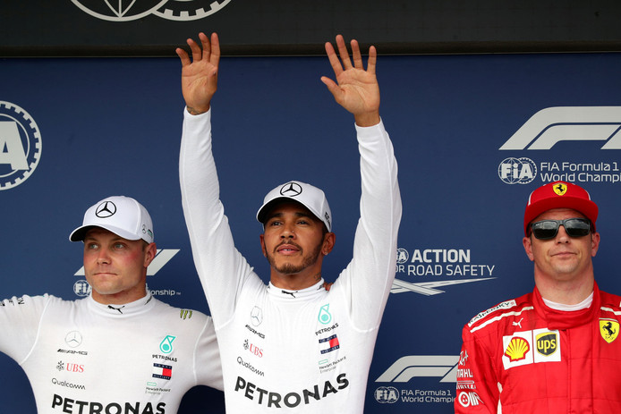 Lewis Hamilton, Valtteri Bottas en Kimi Raïkkönen na de kwalificatie.