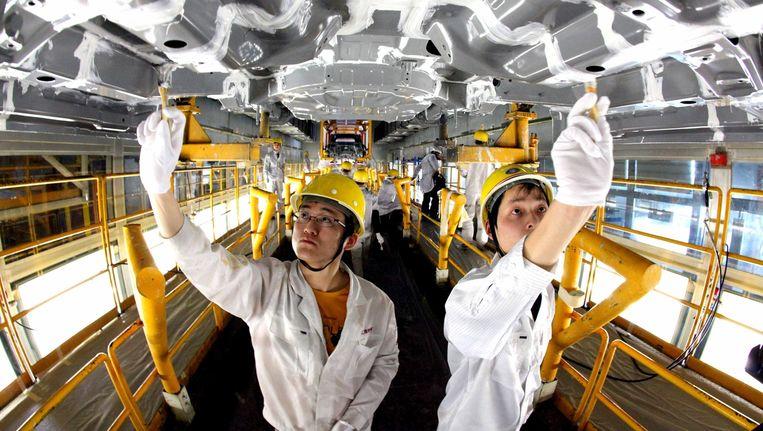 De daling van Chinese autoverkopen in juni wijst op overcapaciteit. Beeld Liu tianfu/AP