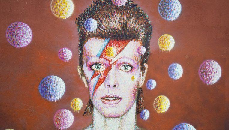 Een muurschildering ter ere van gevallen held Bowie in het Engelse Brixton. Beeld Getty Images