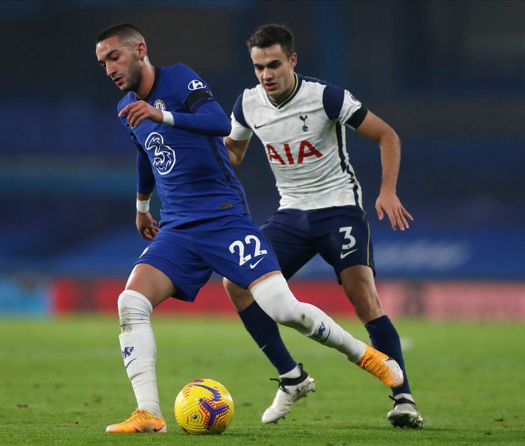 Hakim Ziyech (L) in action against Tottenham's Sergio Reguilon (.