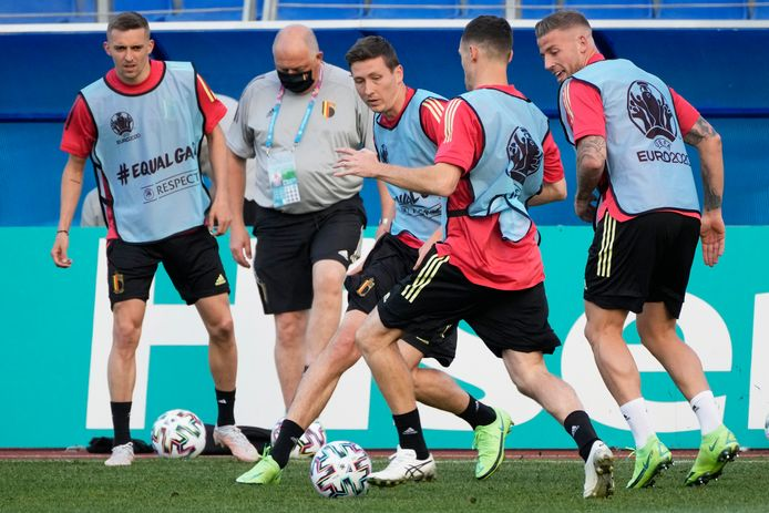 Belgium's Hans Vanaken, center, plays the ball with teammates during a training session of the national team at Petrovsky stadium in St. Petersburg, Russia, Friday, June 11, 2021, on the eve of the Euro 2020 soccer championship group B match between Russia and Belgium. The Euro 2020 gets underway on Friday June 11 and is being played in 11 host cities across 11 countries. The event was delayed by one year after being postponed in 2020 due to the COVID-19 pandemic. (AP Photo/Dmitri Lovetsky)
