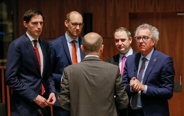 Europese ministers van Financiën onder elkaar, van links naar rechts: Wopke Hoekstra (Nederland), Vincent Van Peteghem (België), Olaf Scholz (Duitsland) en Pierre Gramegna (Luxemburg). Beeld EPA