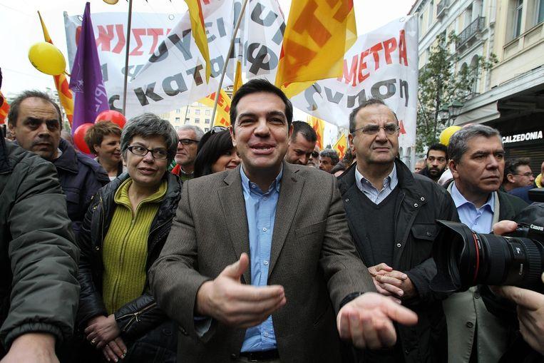 De partijleider van Syriza, Alexis Tsipras, tijdens een demonstratie in Athene eind november. Beeld epa