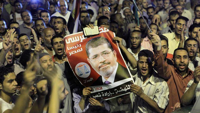 Aanhangers van de Eyptische president Mohammed Morsi. Beeld ap