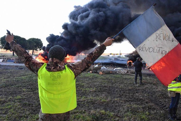De benzinetaks werd afgeblazen onder druk van demonstraties.  Beeld AFP