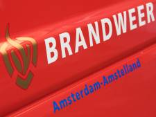 Twee bewoners met ladder geëvacueerd bij woningbrand op Postjesweg