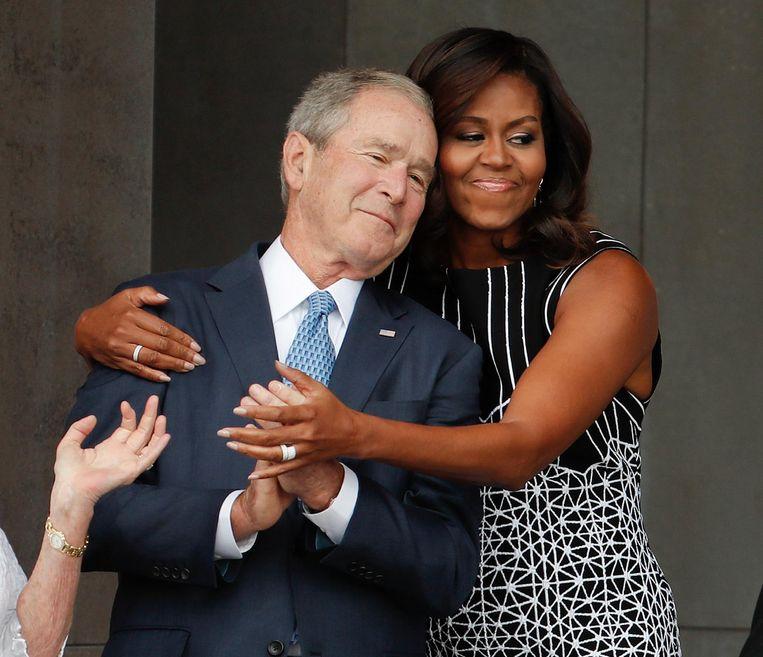 Michelle Obama met oud-president George Bush, devoorganger van haar man.  Beeld  ANP
