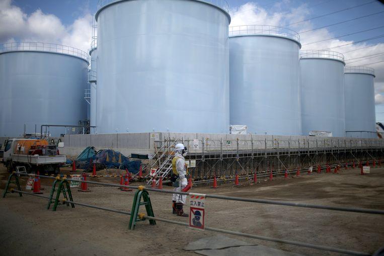 Een deel van de duizend watertanks in Okuma die vol zitten met radioactief water uit de Fukushima-kerncentrale. Beeld Getty Images