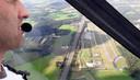 Blik op vliegveld Seppe vanuit de gyrocopter