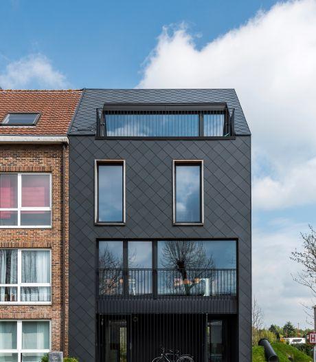 Une classique maison de rangée réinventée: ludique, compacte et passive