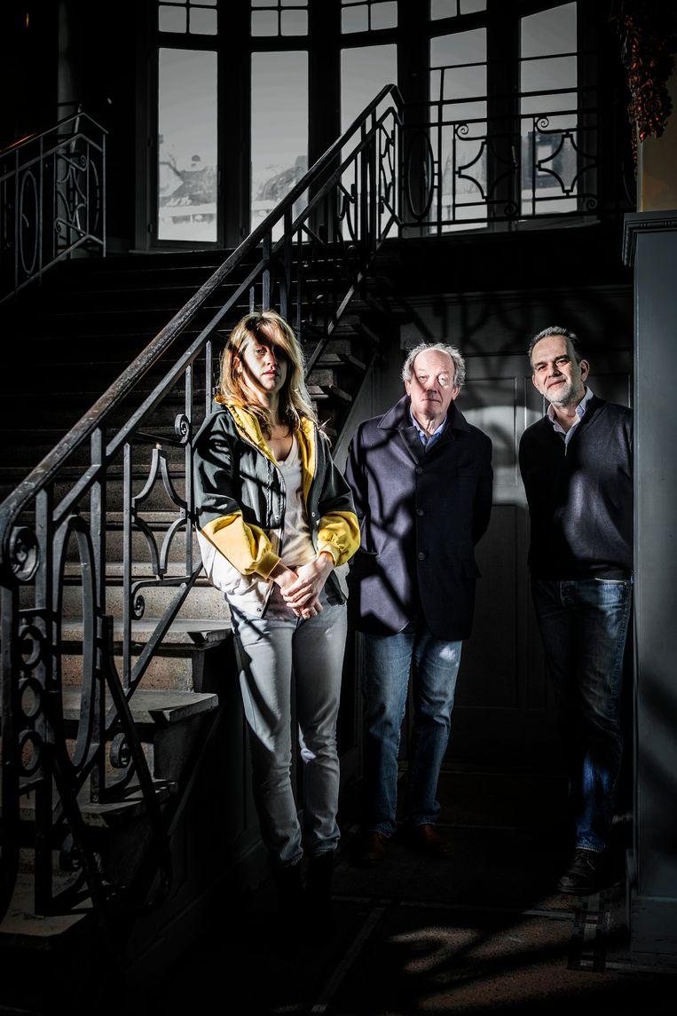 Fien Troch, Luc Dardenne en uitbater Olivier Rey in de pas gerenoveerde Cinema Palace in Brussel. Beeld Franky Verdickt