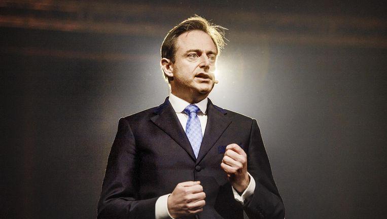 Voorzitter Bart De Wever had op de receptie van zijn partij N-VA een boodschap: er moet ook in dit nieuwe jaar bespaard worden. Beeld Eric de Mildt