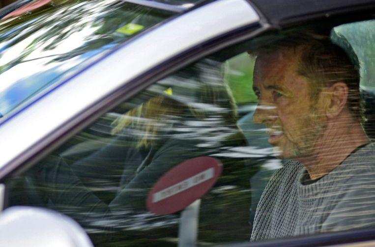 Phil Rudd bij het verlaten van de rechtszaal vandaag. Beeld AP